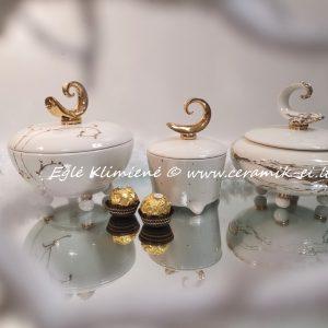 Auksuotos keramikinės dėžutės su amžinybės simboliu
